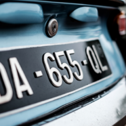 The license plate of an antique car.