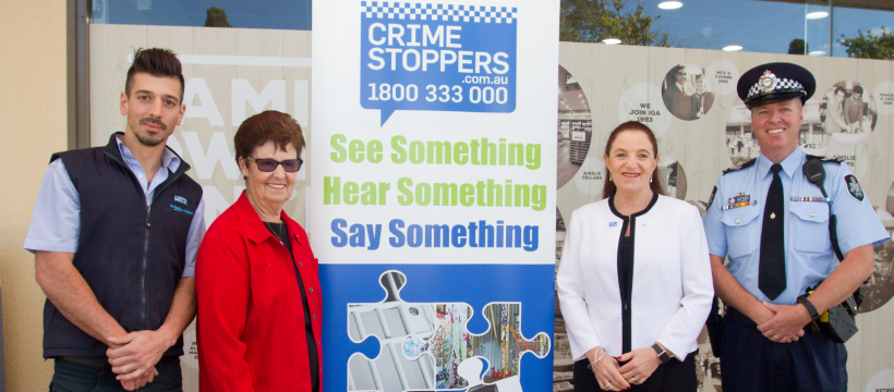 Representatives from Neighbourhood Watch, ACT Region Crime Stoppers, ACT Policing and local retailers launch the Local Suburbs Awareness Campaign.